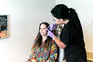 Woman getting botox treatment