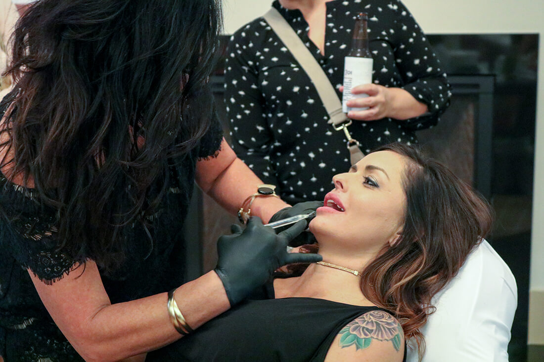 Woman Getting Lip Enhancer Injection
