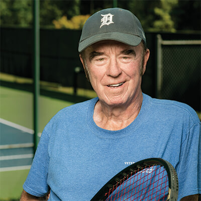 older guy paying tennis
