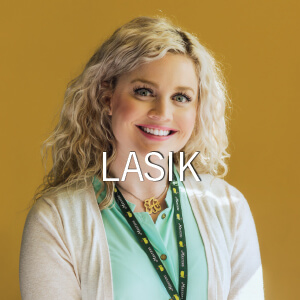 Woman smiling after LASIK